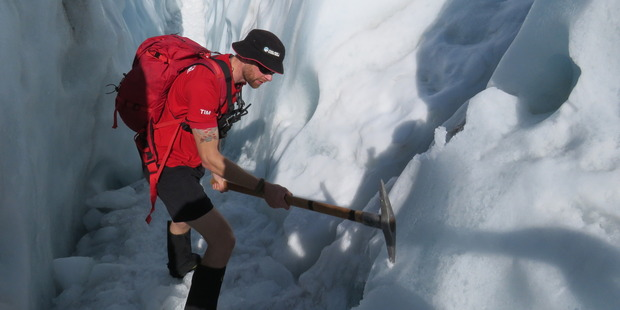 Guide Tim carries out some glacier track maintenance. Photo / Justine Tyerman