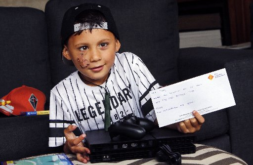 PlayStation NZ come to the party and donate a PS4 and games to Hikurangi boy Tyree Walters. Photo / John Stone