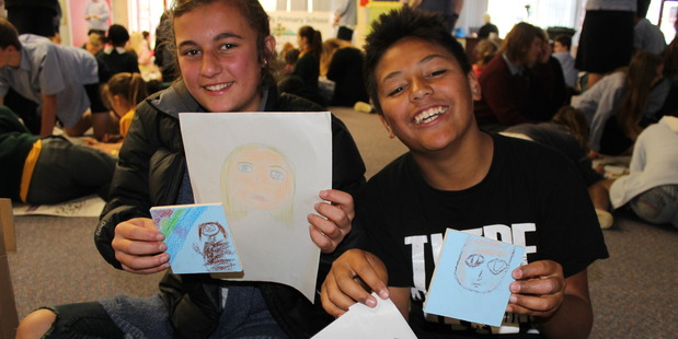 SPECIAL MOMENT: Taliyah Farrell, 13, and Markyrious Farrell, 11, took part in an art project which features a relative of theirs.