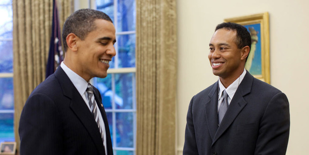 President Barack Obama greets professional golfer Tiger Woods in the Oval Office. Photo / Getty Images.