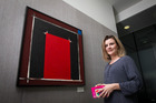 Jessica Moloney, external trustee on the board of the Spark Art Trust with a Ralph Hotere work 'Untitled' from 1997. Photo / NZ Herald