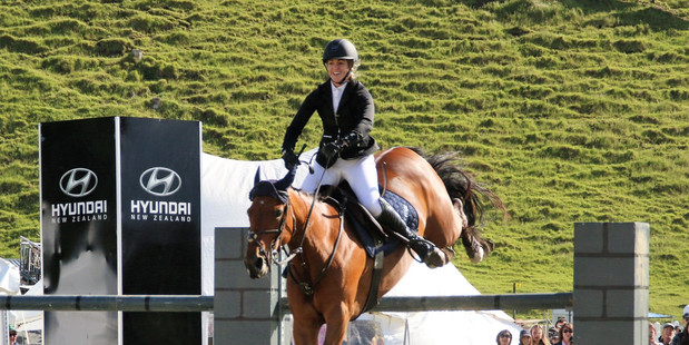 CLASSY: Lucy Olphert clears the final fence on Eve Saint Laurent to win the Hyundai Derby at Mystery Creek. PHOTO/Jane Thompson/NZ Horse & Pony magazine