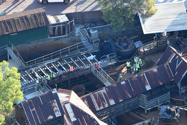 Emergency services attend to the site of the accident at Dreamworld yesterday. Photo / AAP