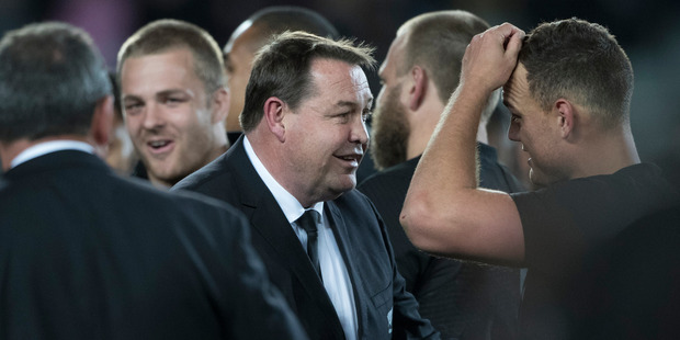Loading All Blacks coach Steve Hansen congratulates his players after beating Australia. Photo / Brett Phibbs