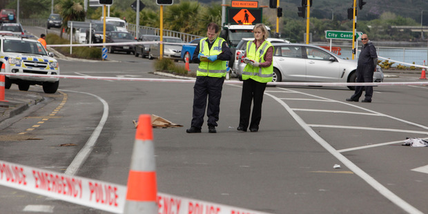 Police close SH4 outside the Red Lion in Whanganui on Saturday after a 24-year-old man was knocked down by a car which fled the scene. Photo/Bevan Conley