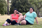 Belle (right) has now lost 90kg and Anastasia (left) has lost 77kg. Photo / Caters News Agency