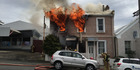 """Firefighters enter a Dunedin flat that was """"totally destroyed"""" in a fire yesterday. Photo / Craig Baxter"""