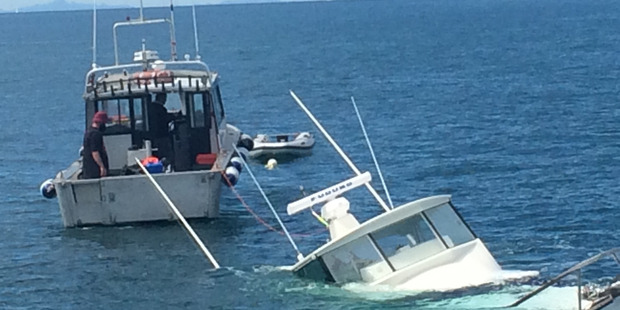 Boat sinking and recovery in the Hauraki Gulf. Photo / Kim Francis