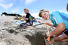 Liam, 9, and Aiden Louw, 6, enjoy the sunny weekend on the beach at Papamoa Domain. Photo/George Novak