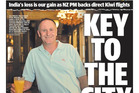 Front page of the Townsville Bulletin featuring John Key relaxing with an orange juice during his unplanned stopover in Townsville. Photo / Supplied