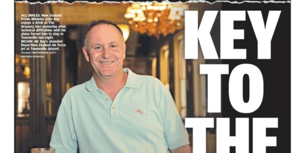 Front page of the Townsville Bulletin featuring John Key relaxing with an orange juice during his unplanned stopover in Townsville following mechanical problems with his Air Force aircraft Photo s