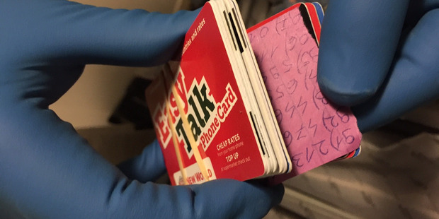 Police found cloned swipe cards and pieces of paper with handwritten PIN numbers. Photo / Supplied.