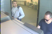 Ionut Bilea, left, and Emanoil Pirjol caught on camera using skimmed cards at an ATM.