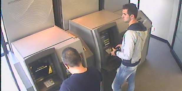 Emanoil Pirjol (left) and Ionut Bilea caught on camera using skimmed cards at an ATM. Photo / Supplied.