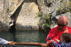 CELEBRATION: Master carver and artist Matahi Whakataka Brightwell, pictured with one of his grandchildren, at his carving of Ngatoroirangi in Mine Bay, Lake Taupo. PHOTO/SUPPLIED
