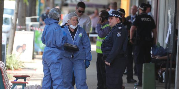 Police at a crime scene involving a bus in Moorooka Brisbane. Photo / News Ltd