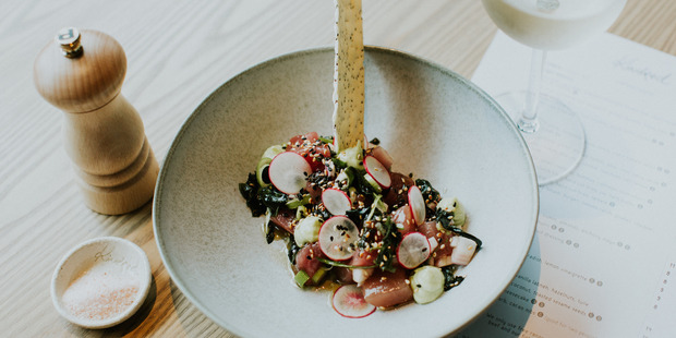 Tuna Poke with Avocado, Wakame Seaweed, Brown Rice and a Chia Cracker at Kindred. Photo / Supplied