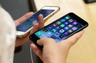 After releasing a new version of its bestselling device, Apple likely sold 45 million units of all types of iPhones in the most-recent fiscal quarter ending September. Photo / AP