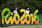 In this Aug.16, 2016 file photo, Kelly Tan, left, and Michelle Koh both of Malaysia, pose for a photo with the Rio 2016 logo on the 16th hole. Photo / AP.