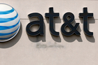 AT&T would also inherit Time Warner's debt, bringing the total value of the transaction to US$108.7 billion. Photo / AP