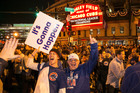 Chicago Cubs fans celebrate outside Wrigley Field after the Cubs reached the World Series. Photo / AP