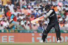 Kane Williamson plays shot during their third one-day international cricket match against India in Mohali, India. Photo / AP
