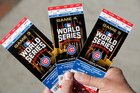 Chicago Cubs baseball fan Robert Lyons shows his World Series tickets outside Wrigley Field. Photo / AP