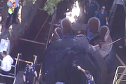 In this image made from video, rescue personnel stand by the Thunder River Rapids ride at Dreamworld. Photo / Channel 9 via AP