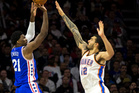 Steven Adams attempts to contest the shot of Joel Embiid during the Thunder's win. Photo / AP