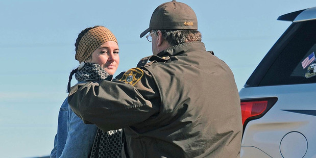 A Morton County Sheriff's deputy officer arrests actress Shailene Woodley at a protest against the Dakota Access Pipeline near St. Anthony. Photo / AP