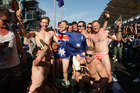 Australian mates the Budgie Nine were facing jail time for stripping to their budgie-smugglers, Malaysian flag on the back, at the Grand Prix. Photo / AP