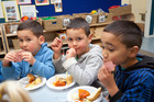 Codah Orchard, 4, (left) Chance Orchard, 4, and Maungaarangi Hastie, 4, eating at ABC Childcare in Greerton. Photo / Andrew Warner