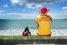 A surf lifesaver at Red Beach, Auckland. Photo / Doug Sherring