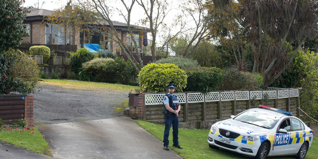 The home of Ross and Clare Bremner under police guard. Photo / Alan Gibson.