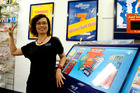 Linda Zeng from AJ's Lotto in Tauranga has been rushed off her feet with customers after selling a first division winning ticket. Photo/file