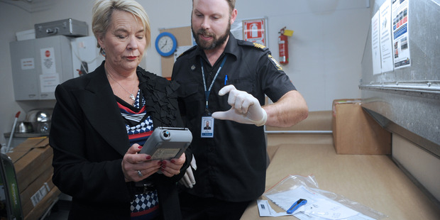 Customs Minister Nicky Wagner tries out one of the FirstDefender mobile substance devices that will assist NZ Customs officers in identifying drugs at the border. File/Photo.