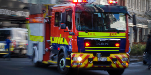 Two people have been injured in a van fire in Franz Josef Glacier tonight. Photo / Nick Reed