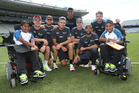The Black Caps cricket team meet disabled brothers at Eden Park, made possible by the Halberg Foundation. Photo / Doug Sherring