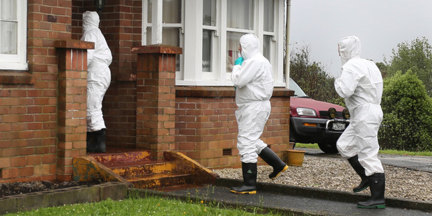 Police and ESR staff at the scene of a methamphetamine lab raid during Taskforce Easter. Photo / Northern Advocate