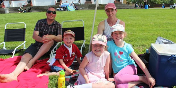 DAY IN THE SUN: The Groube family from Palmerston North enjoyed a picnic on the lawn in front of the public stand at the Woodville/Pahiatua Racing Club's Sunday meeting. PHOTOS/CHRISTINE McKAY