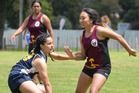 Bay of Islands College player Pearl Uren-Te Kuru reaches for the ball while fending off Teowai Ashby from Dargaville High School during the touch tournament at Kaikohe. Photo / Debbie Beadle