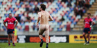 A streaker invades the field during the Mitre 10 Cup Semi between Taranaki and Tasman. Photo / Getty Images