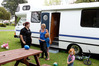FULL HOUSE: Kennedy Park Holiday Resort receptionist Kat Stanford chats to Aimee Wilson, Brenden, 7, and Charlotte, 20 months from Dargaville. Photo Duncan Brown