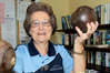MEMORABILIA: Amongst the other memorabilia club patron and life member Jean Wylie holds some wooden bowls from about the 1930s. PHOTO/WARREN BUCKLAND