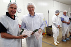 John Bostock (left) shows Labour List MP David Parker the workings of Bostock Organic Chicken factory in Hastings. Photo / Paul Taylor