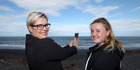 Jane Tarrant and daughter Niamh Muldowney had more than 100 Facebook shares of an orca video Jane shot at Mahia at the weekend. Photo / Duncan Brown