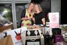 Great cause: L-R: Mandy Stork and Carina Kelly, with items which will be auctioned at Corks for Life, a fundraiser for Kirsty Webb who is having medical treatment in Germany. Photo/Duncan Brown.