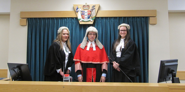 Angeline Nielsen, left, and Jade Newton flanked by Justice Christian Whata after the admission ceremony in the High Court at Whangarei. Photo / Imran Ali