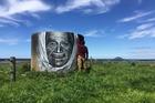 Mr G painting a portrait of respected elder Tarere Wai O Rangi McMillan on the highest peak of Matakana Island. Photo/Melissa Hoete