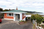 The house does have one redeeming feature - a stunning view of Whangarei Harbour. Photo / John Stone
